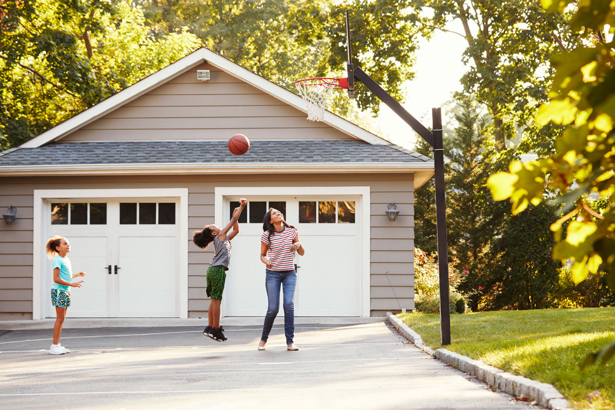 playing basketball at the golden hour in the driveway